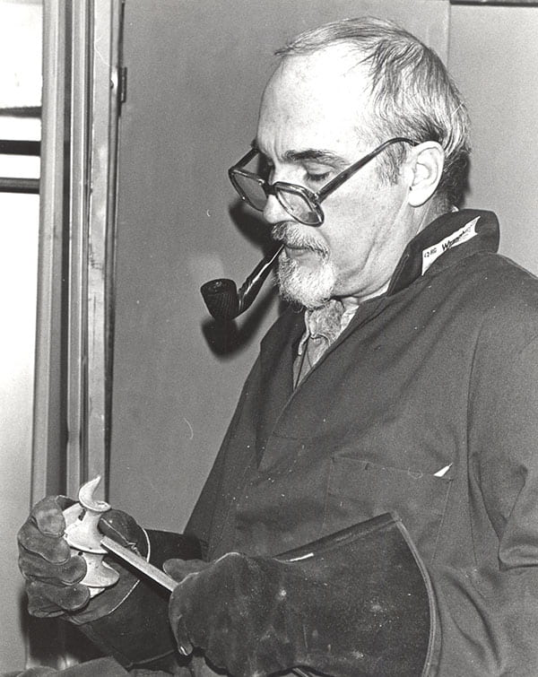 A pipe was a trademark of Father McAlister, seen here doing some filing.