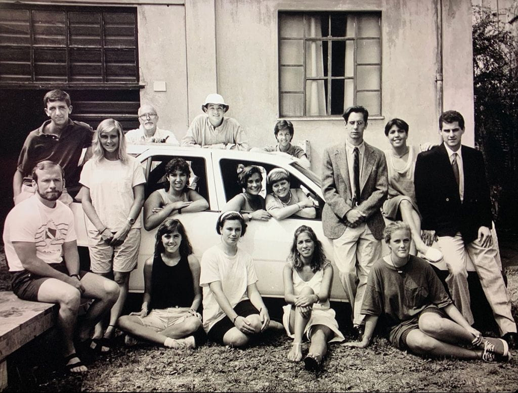 Students and faculty in the Pietrasanta program pose for a group photo in summer 1989. Father McAlister is second from left at rear. At front left is current College President Rev. Brian J. Shanley, O.P. '80. Stephen J. Forneris '90, who contributed this photo, is leaning on the car, third from right.