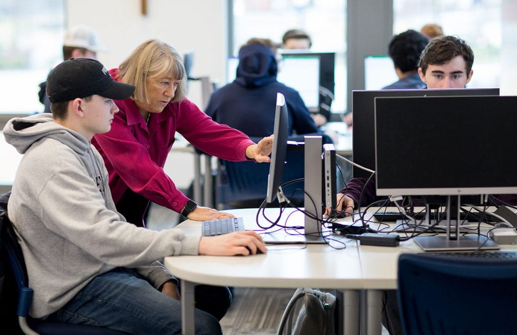 Faith Lamprey teaching Data Applications in Business to students in the new computer laboratory she made possible with a $500,000 gift to the College.