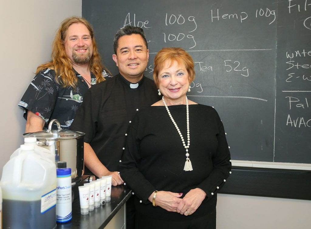 Dr. Robert Camp '18G, Rev. Nicanor Austriaco, O.P. '20G, and Dr. Helen Caldwell are partners in Semper Veritas, a new business that created For Good, a rejuvenating hand cream.