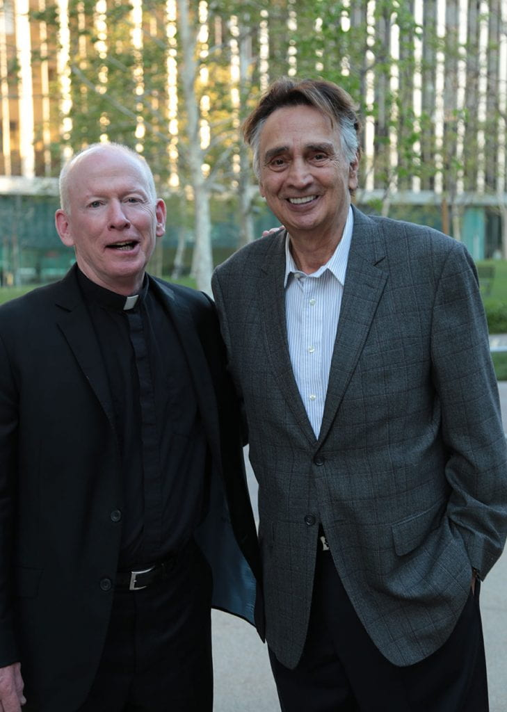 John Bowab '55 & '89Hon. meets with College President Rev. Brian J. Shanley, O.P. '80 during an alumni event in Hollywood in May 2018.