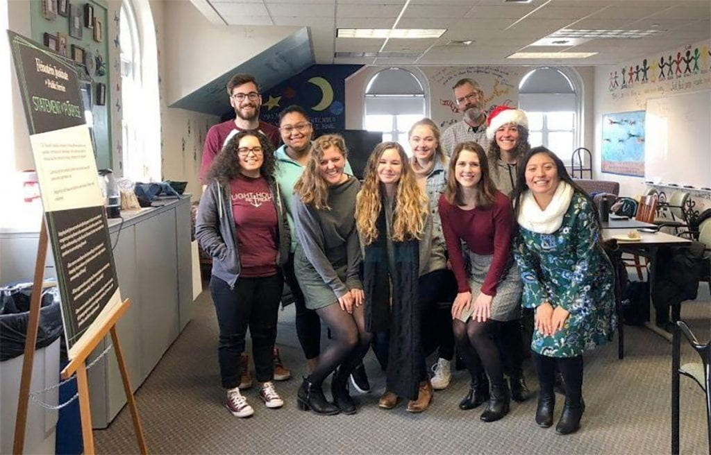 Katherine, front right, student peers, and instructors celebrate the final day of the public and community service studies practicum for the fall 2091 semester. With her are, front row from left, Ariel Davey '20, Amelia Aaron '20, Sara Murphy '20, and Emily Locke '20. At rear are William Bozion '19, Perla Castillo Calderon '20, Colleen Tuite '20, Dr. Keith Morton, professor and department chair, and Rebecca Twitchell, instructor in public and community service studies.