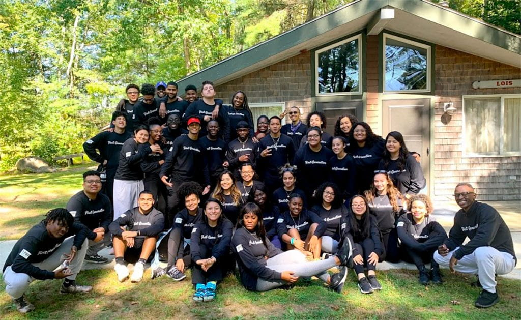 Katherine, sitting at front row left, is joined by other student mentors and mentees during a retreat for the Peer Mentoring Program in fall 2019. She was a peer mentor the last two years.