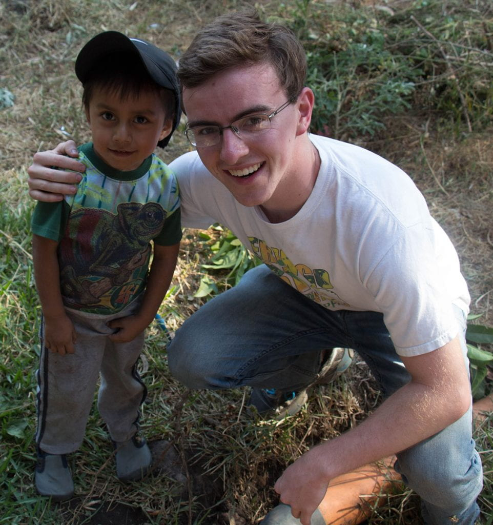 During a theology course trip to Guatemala, Jack Murphy '20 poses with a young boy.
