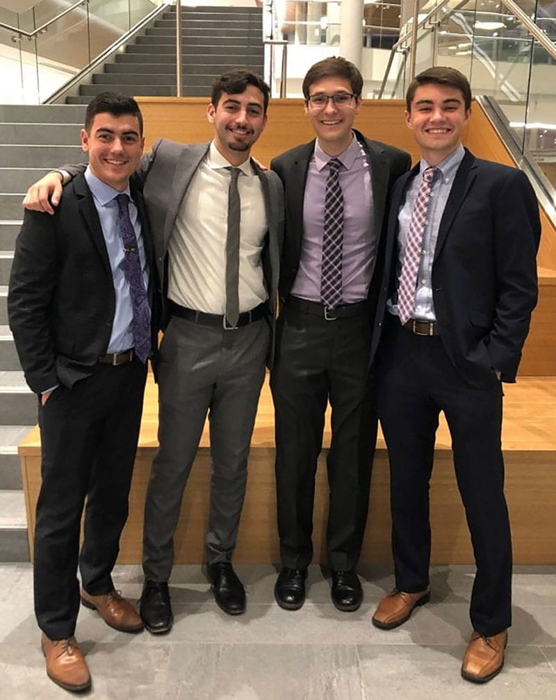 Nathan Perez '20, second from left, was a member of the winning team in the 2019 Michael Smith Regional Ethics Case Competition sponsored by the PC School of Business. He is joined by teammates, from left, Daniel Bonner '20, Shawn McDermott '20, and Alec DiCiaccio '20.
