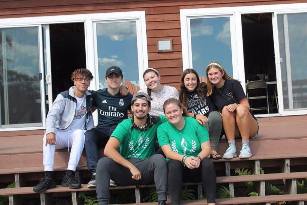 Nathan Perez '20 leads a Campus Ministry Connections program retreat last year for first-year students. Alongside him is another leader, Caroline Shaper '22. At rear from left are Yamel Camilo '23, Gabriel Cardenal '23, Analisa Pisano '23, Sara Filler '23, and Katie Glinka '23.