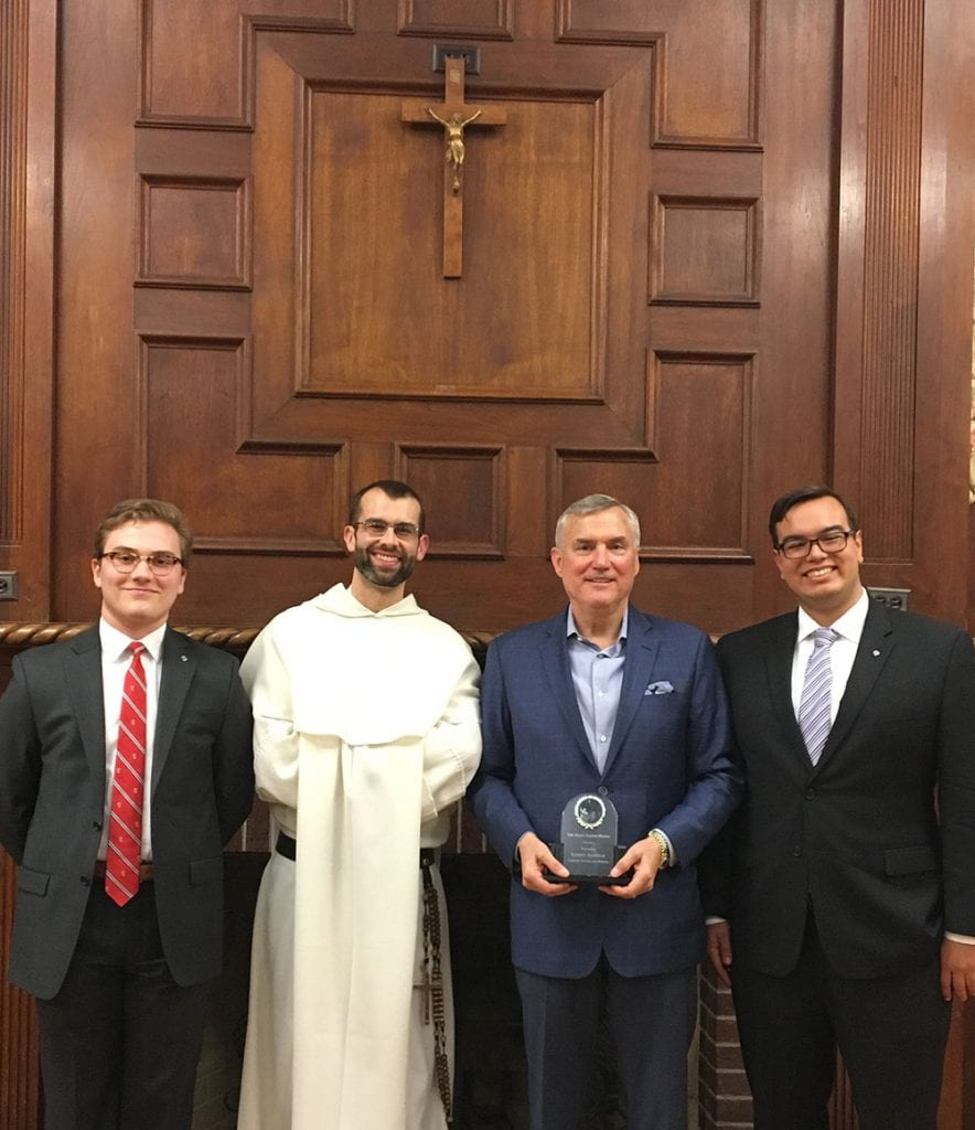 Sean Tobin '20, left, who was grand knight of PC's Knights of Columbus council the past two years, conferred the St. Joseph Award to Leonard N. Alsfeld '74, third from left, at a council meeting in 2018. Others are Rev. Bonaventure Chapman, O.P. and Nathaniel Thomas '18 (now Brother Nicodemus Thomas, O.P.).