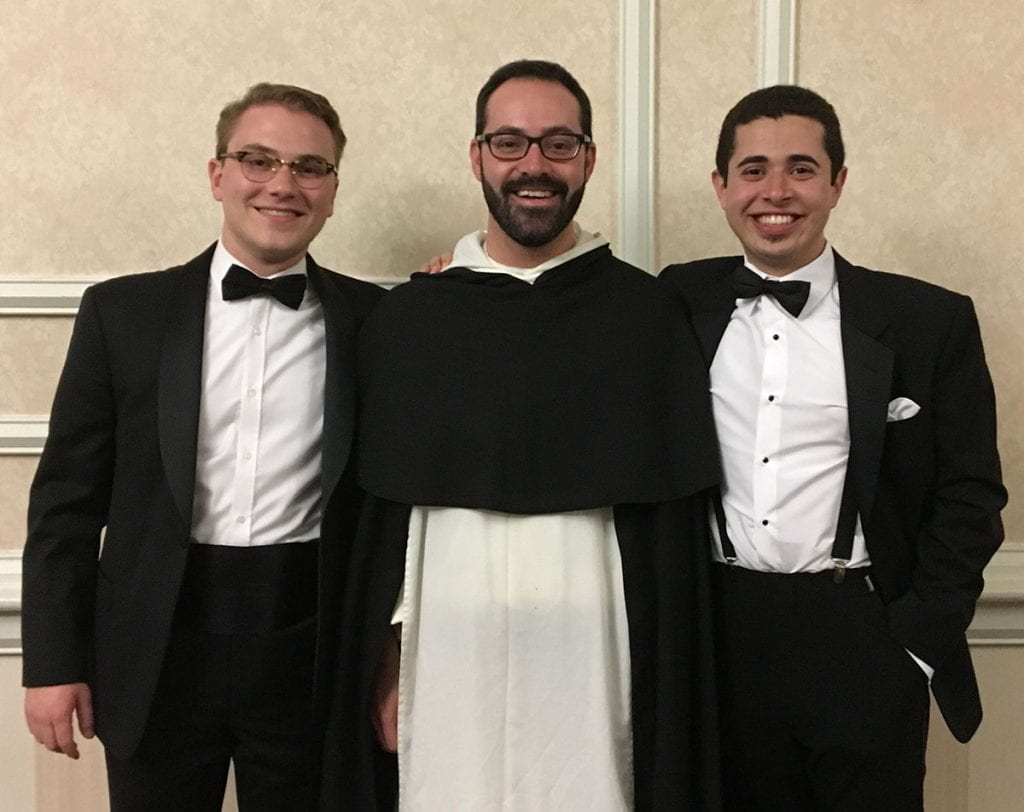 From left, Sean Tobin '20, Rev. Michael Weibley, O.P., associate College chaplain, and Daniel Arteaga '19 (now Brother Raphael Mary Arteaga) at the Class of 2019 commencement formal night