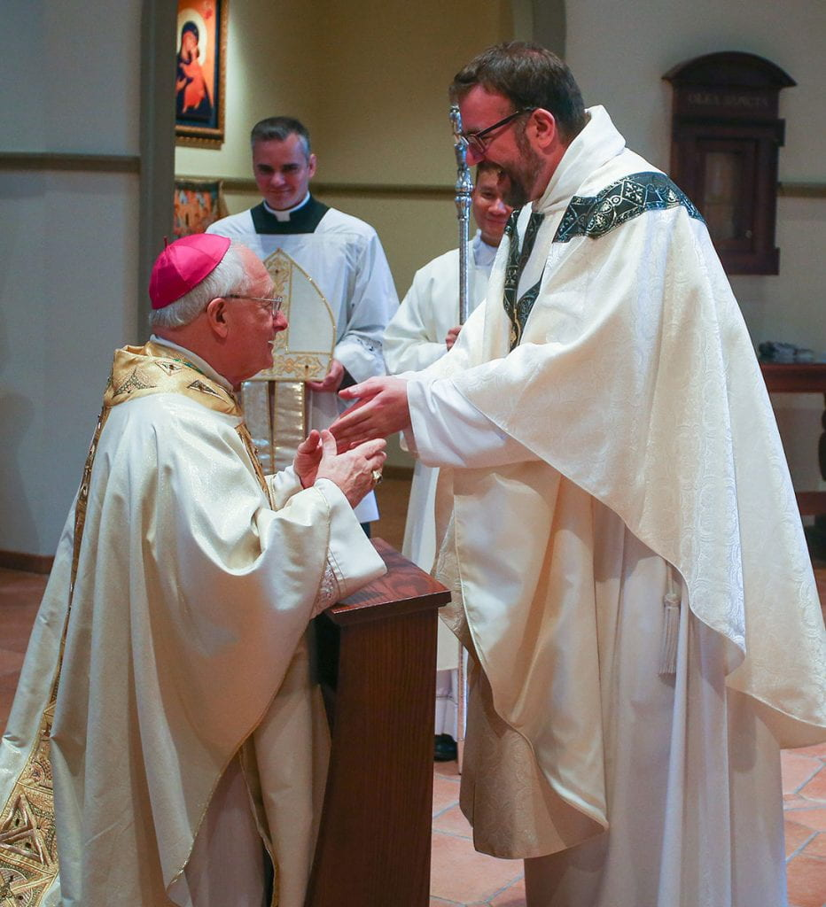 Rev. Jordan Zajac, O.P. '04 is congratulated by Most Rev. Robert C. Evans, auxiliary bishop of Providence.