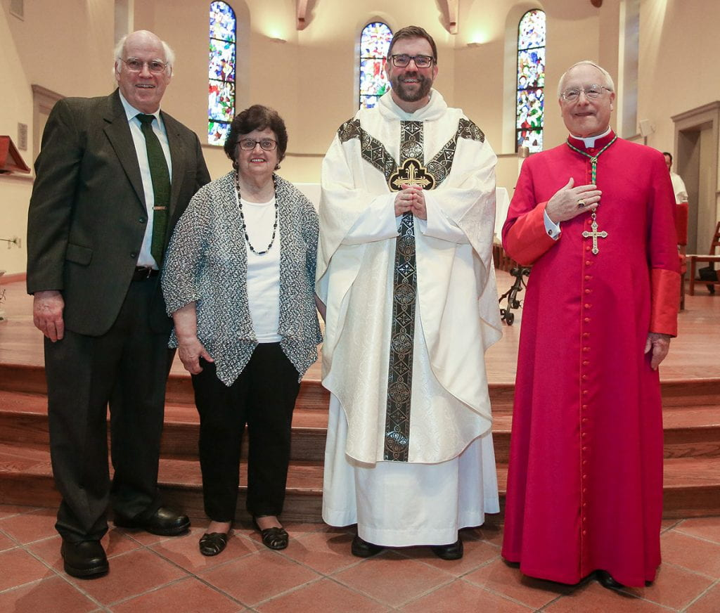 Father Jordan Zajac, O.P. '04 with his parents, Peter and Judith Zajac, and Most Rev. Robert C. Evans, auxiliary bishop of the Diocese of Providence.