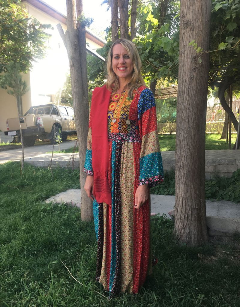 Laurie Hart '03 wears a traditional Afghan dress she was given by her students in Afghanistan.