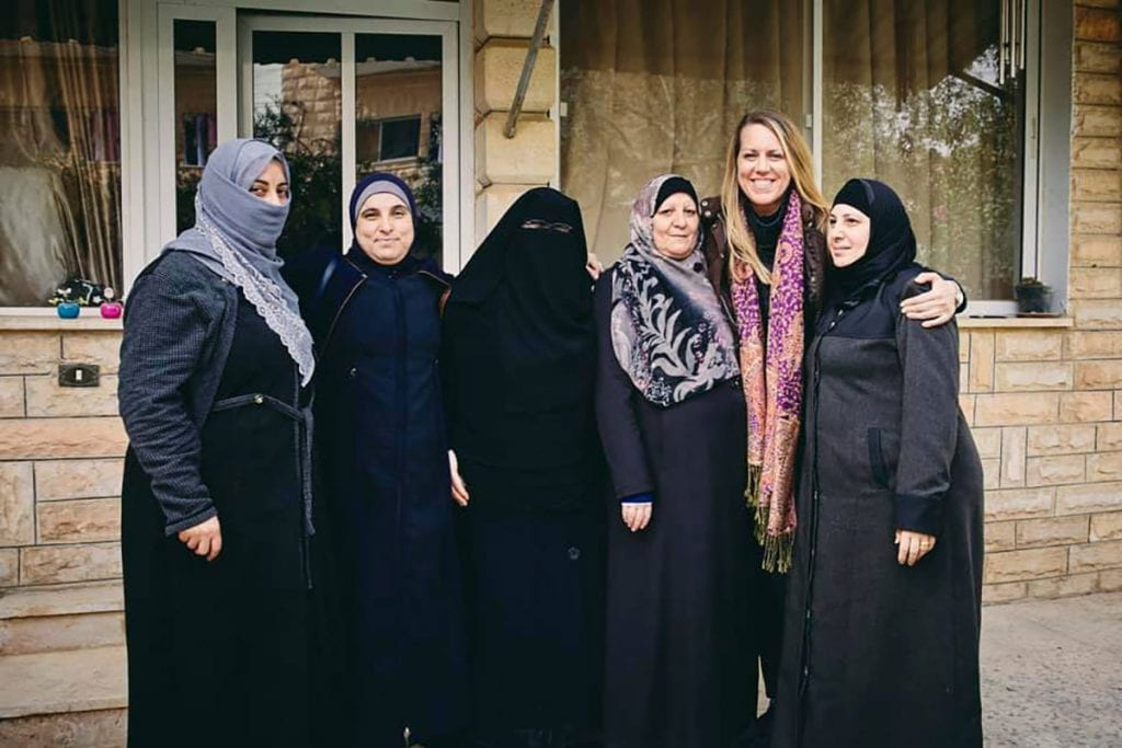 Laurie Hart '03 visits with knitters in Mafraq, Jordan.