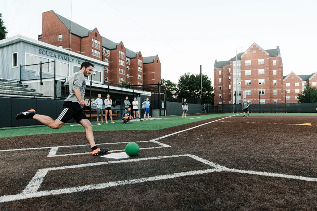 A student takes aim during an intramural kickball game on Glay Field, home of the Providence College softball team.