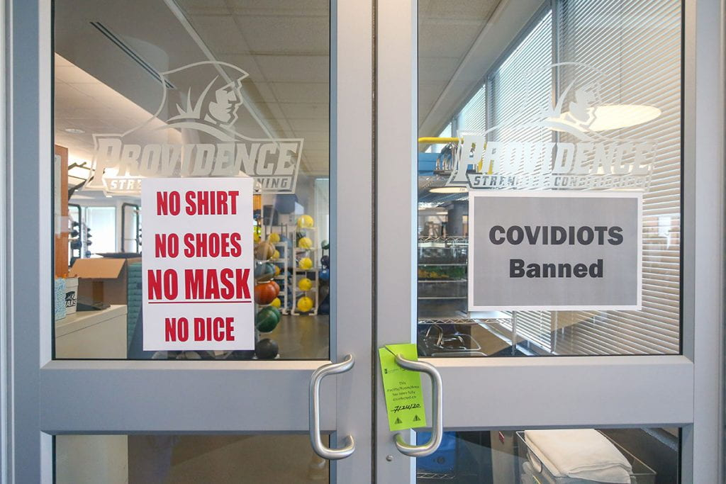 No-nonsense messages on the door of the strength and conditioning room.