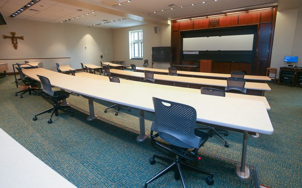 The number of seats in a lecture hall in the Ruane Center for the Humanities have been reduced to encourage physical distancing.
