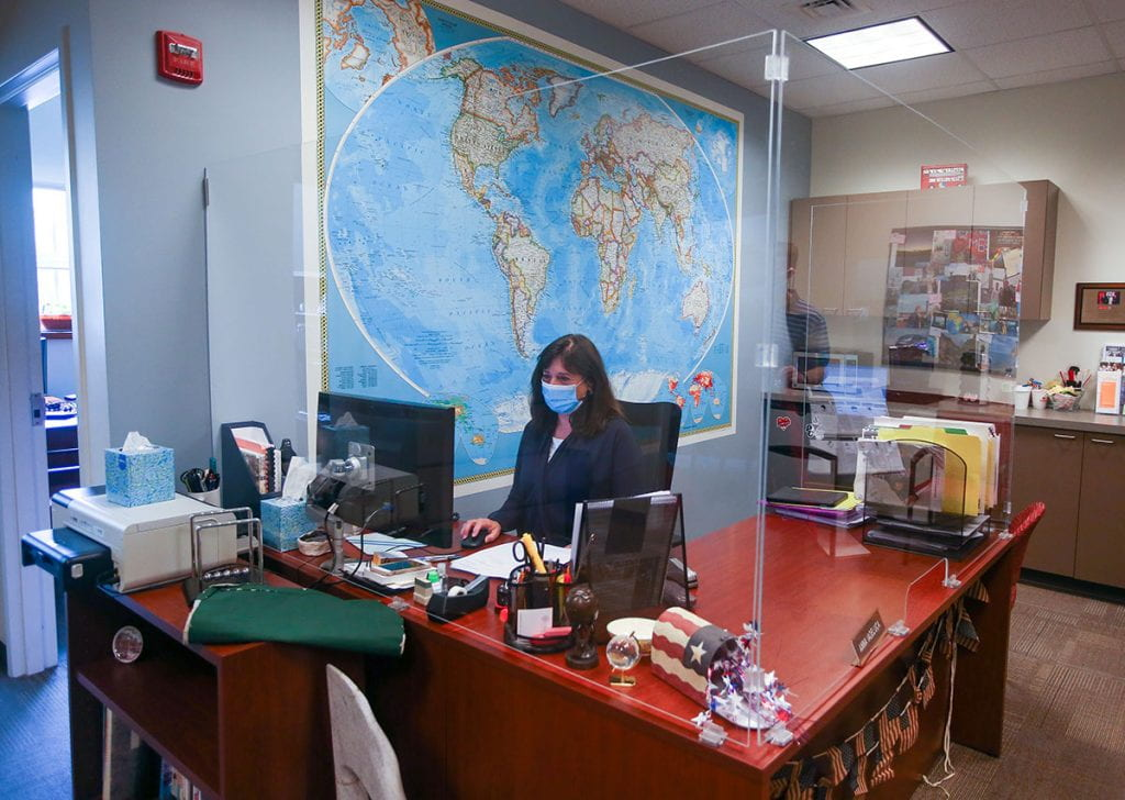 New plexiglass has been installed around the desk of administrative coordinator Anna Iadeluca in the Center for Global Education.