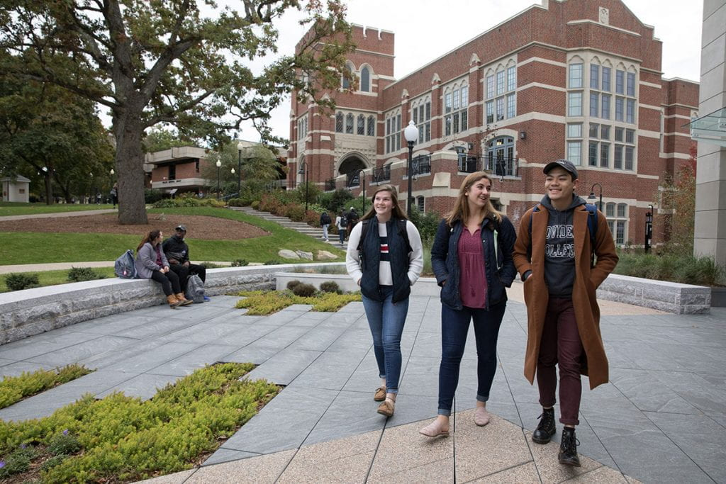 """Victoria Haak '20 says she fell in love with the Providence College campus during her first visit as a high school senior. """"It was this feeling of family and love that I don't think I had anywhere else,"""" she said. She is shown with Anna LaFortune '22, left, and Hieu Nguyen '22."""