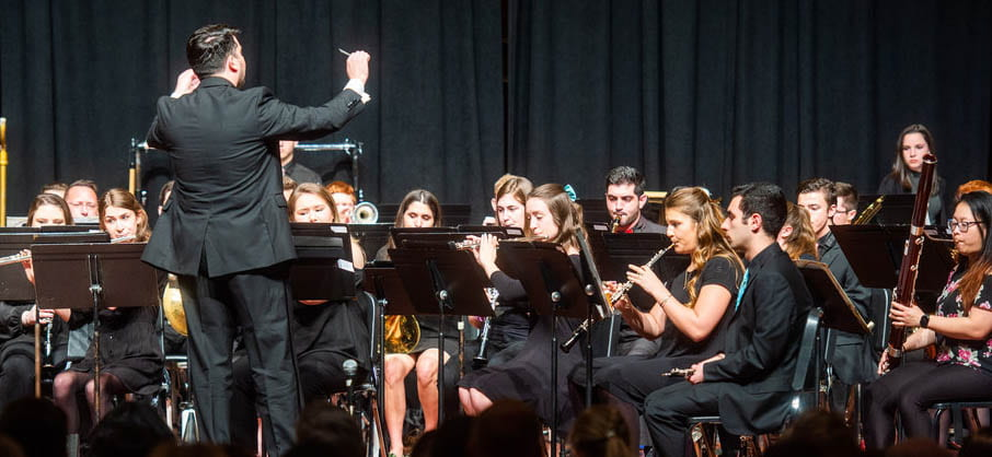 Photo of Eric Melley conducting Symphonic Winds in Spring 2019