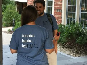 "Students wearing ""Pact"" program t shirts that read inspire ignite impact"