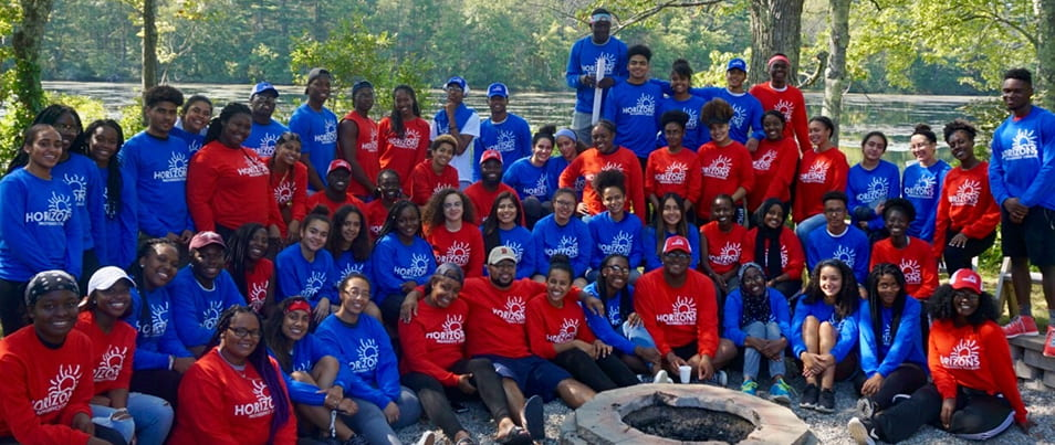 Horizon students in red and blue shirts at a retreat