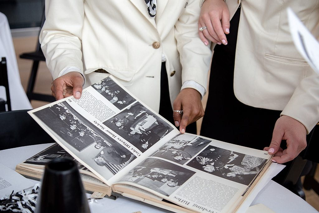two people looking at yearbook