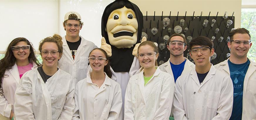 A group of Chemistry students posing with the PC Mascot