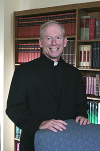 An image of Father Shanley in his office at Providence College