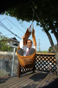 Professor Shigeyoshi Osaki demonstrates the strength of spider silk by swinging in a hammock supported by threads he harvested.