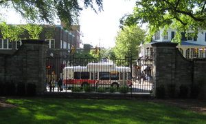 CATA bus on College Avenue, pictured through the Allen Street Gates
