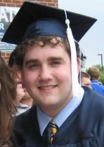 Brad in academic regalia