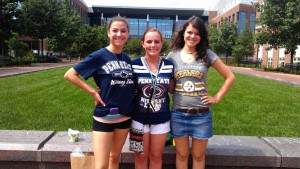 Madison Oliver (center) and sisters ?? upon her arrival at Penn State University Park last year.