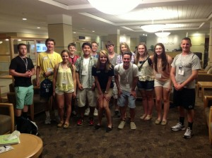 A group of students and their orientation leader during LateNight activities at New Student Orientation.