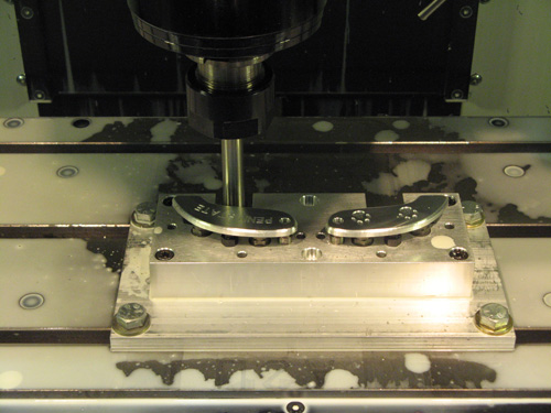 Figure 11. Spindle Mounted Ejector Used to Automatically Force the Machined Workpieces from the Head Out Grippers
