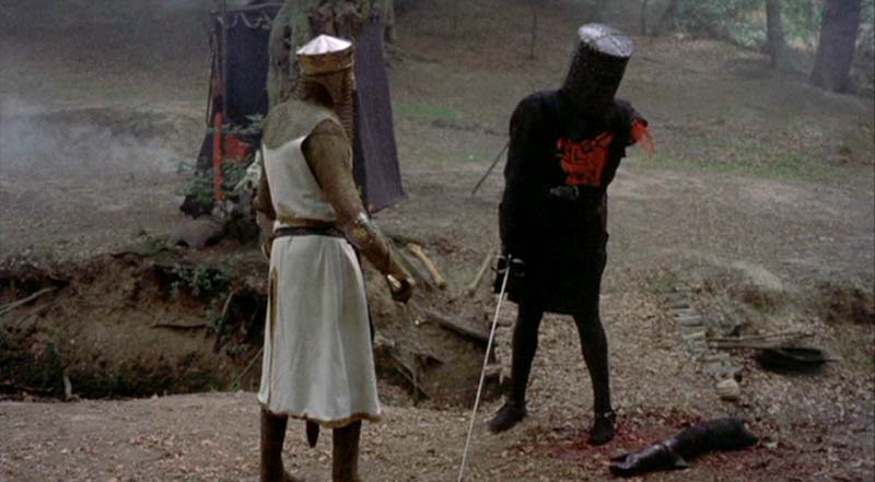 """The Black Knight always triumphs!"" says the limbless fighter as he attempts to defeat King Arthur by kicking him."