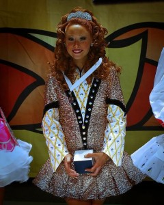 This dancer is holding a placement medal from the World Championships