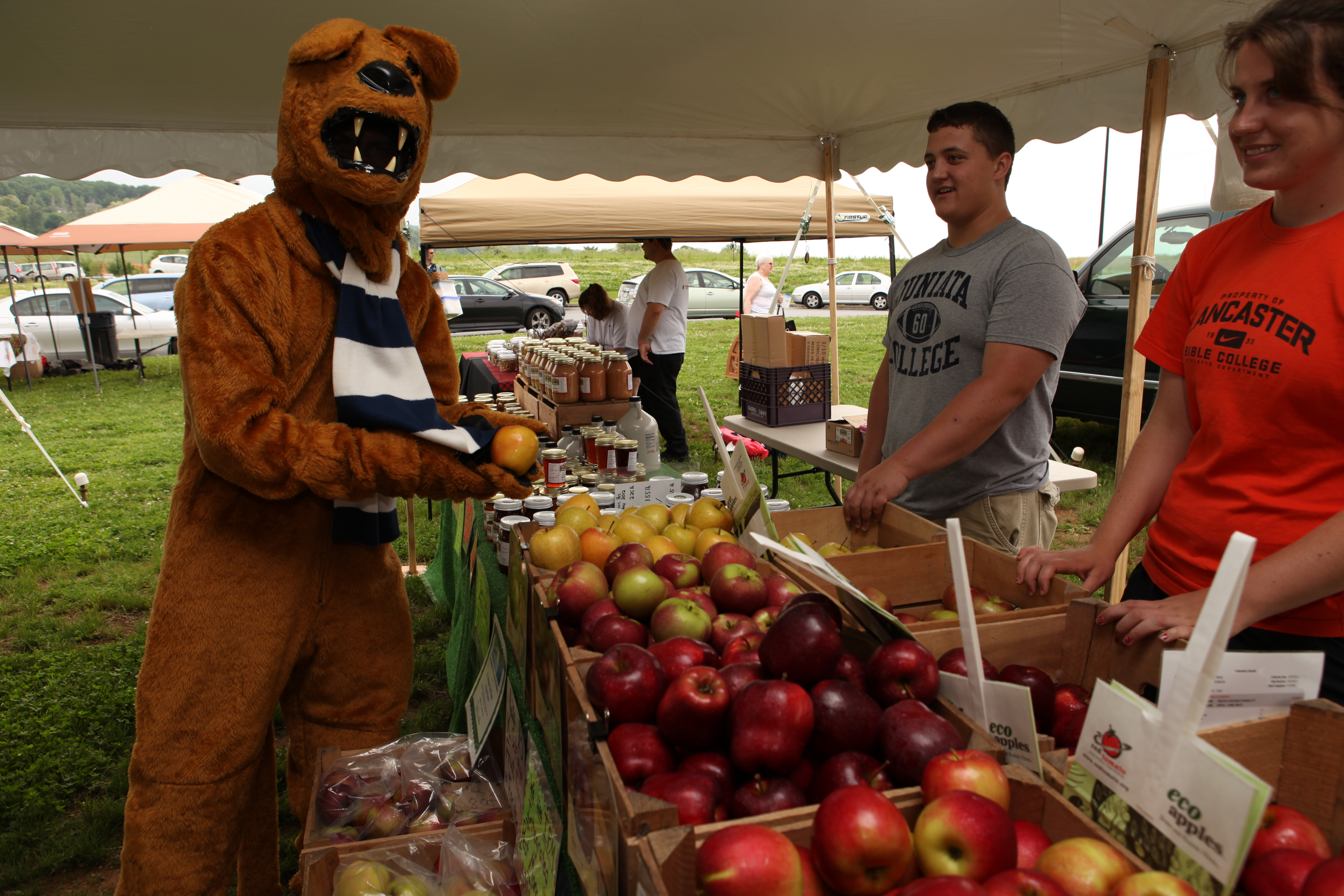 nittany lion with students and vegetables