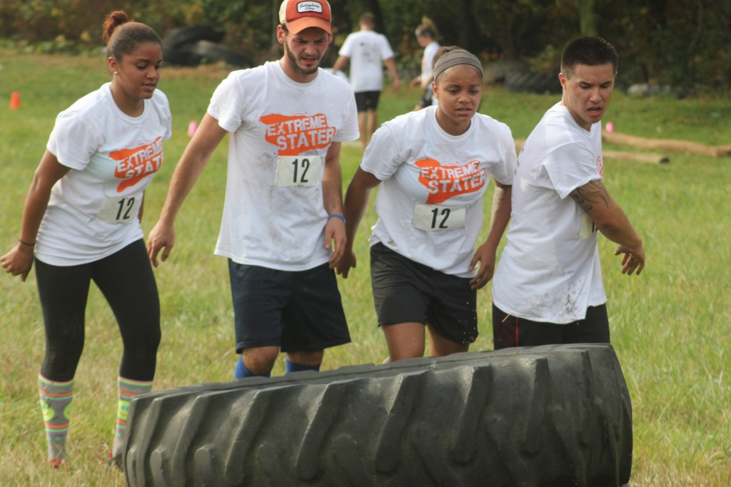 team at Extreme Stater flips tire