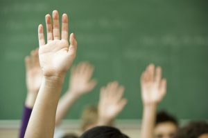 Hands raised in classroom