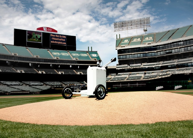 Aerospace engineering alumnus Zach Olshenske helped to built this telerobot, allowing a boy to throw the first pitch at a Yankees-Athletics baseball game without being at the stadium.