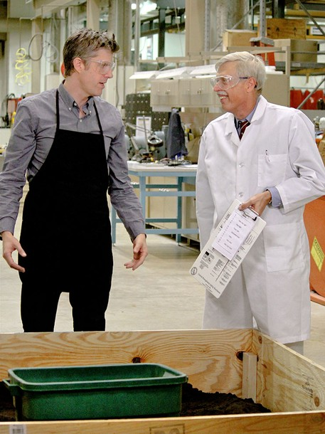 """National Geographic show host David Rees, left, dicusses a shovel experiment with Andris Frievalds, professor of industrial engineering. In the """"Going Deep With David Rees"""" segment, the two measured the workload, which is the pounds of dirt Rees was able to move with each shovel compared to his physical exertion, oxygen and heart rate. (Photo credit: National Geographic)"""
