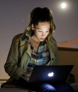 Girl typing on laptop photo