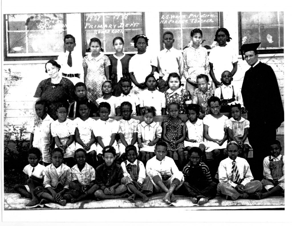 1937-38 Hopewell primary students in four rows outside of school