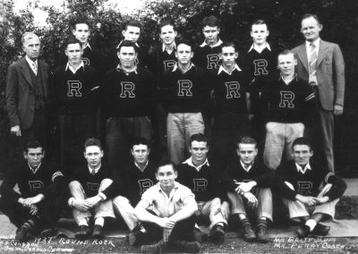 1937 Round Rock football team with coaches wearing letterman sweaters