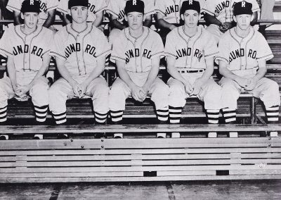 three rows of Round Rock HS baseball players dressed in uniforms