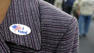 I Voted sticker on woman's lapel