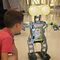 photo of student with robot