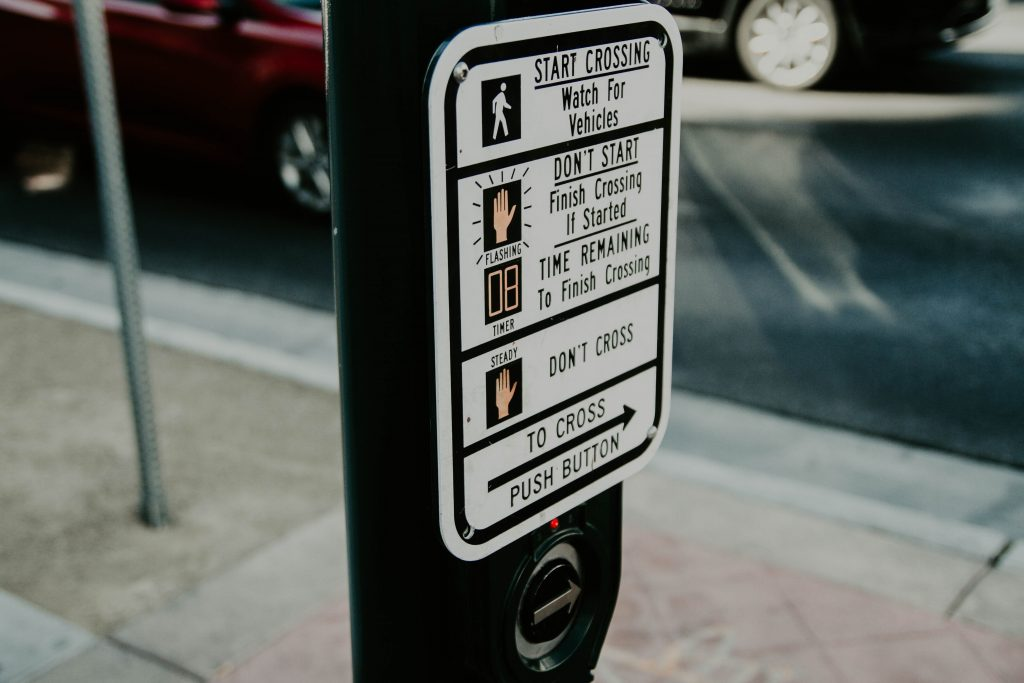 Photo of traffic signal crosswalk with written instructions