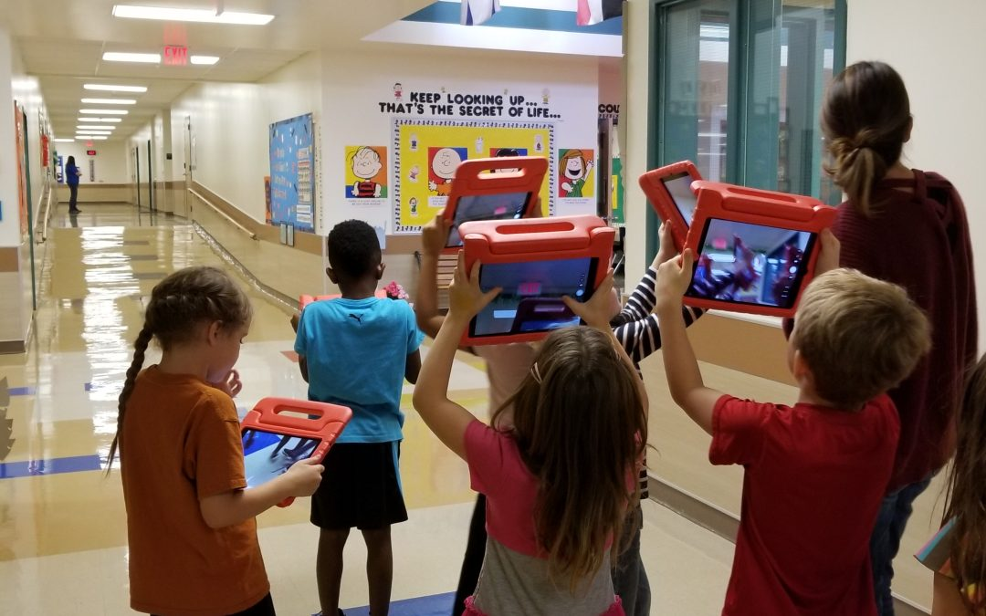 Mrs. Burnikel's 1st grade class is searching for light energy and using the IPADS to create a piccollage!