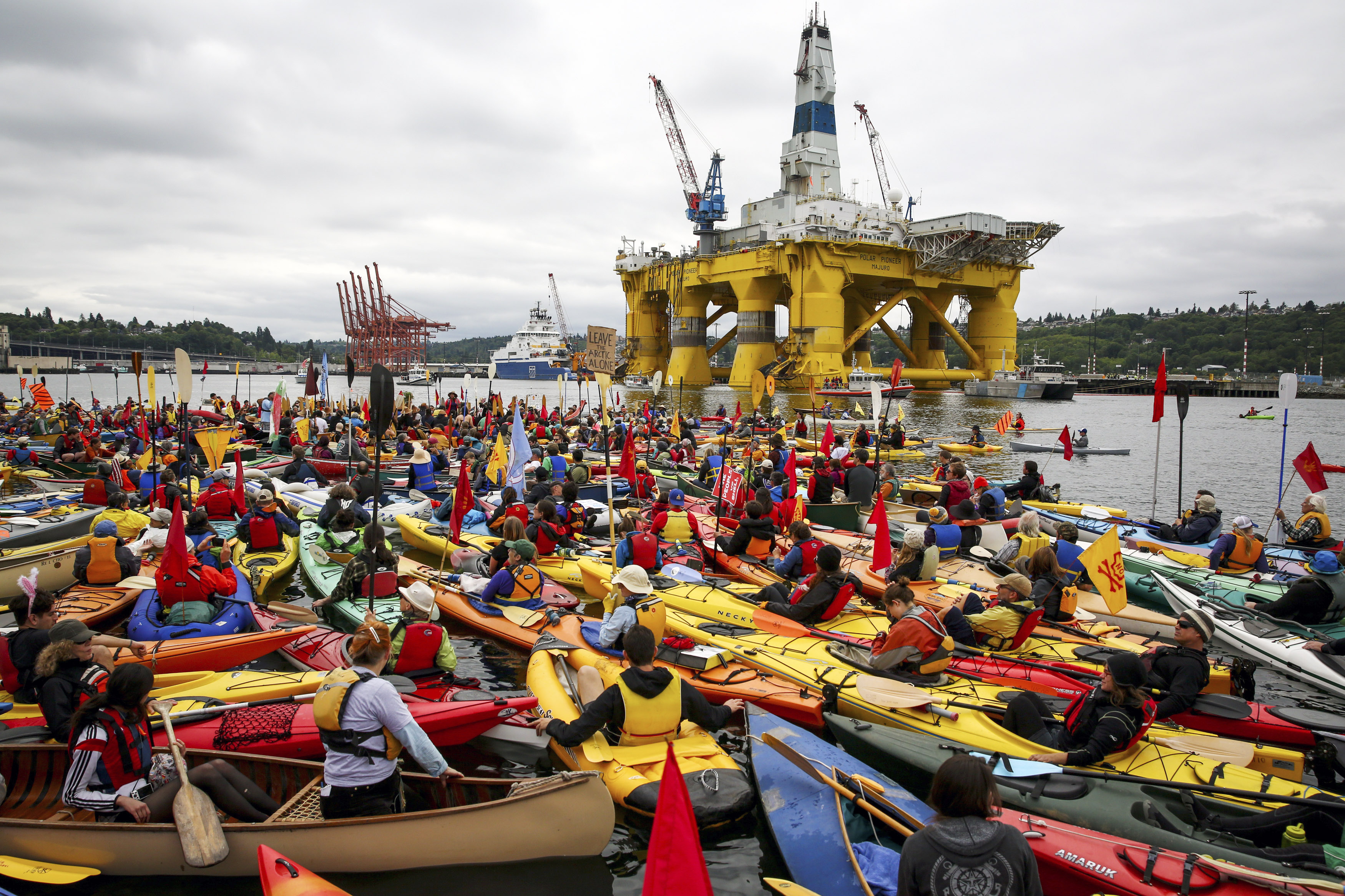 "Activists who oppose Royal Dutch Shell's plans to drill for oil in the Arctic Ocean prepare their kayaks for the ""Paddle in Seattle"" protest on Saturday, May 16, 2015, in Seattle. The protesters gathered at a West Seattle park and then joined hundreds of others in Elliott Bay, next to the Port of Seattle Terminal 5, where Shell's Polar Pioneer drilling rig is docked. (Daniella Beccaria/seattlepi.com via AP) MAGS OUT; NO SALES; SEATTLE TIMES OUT; TV OUT; MANDATORY CREDIT"