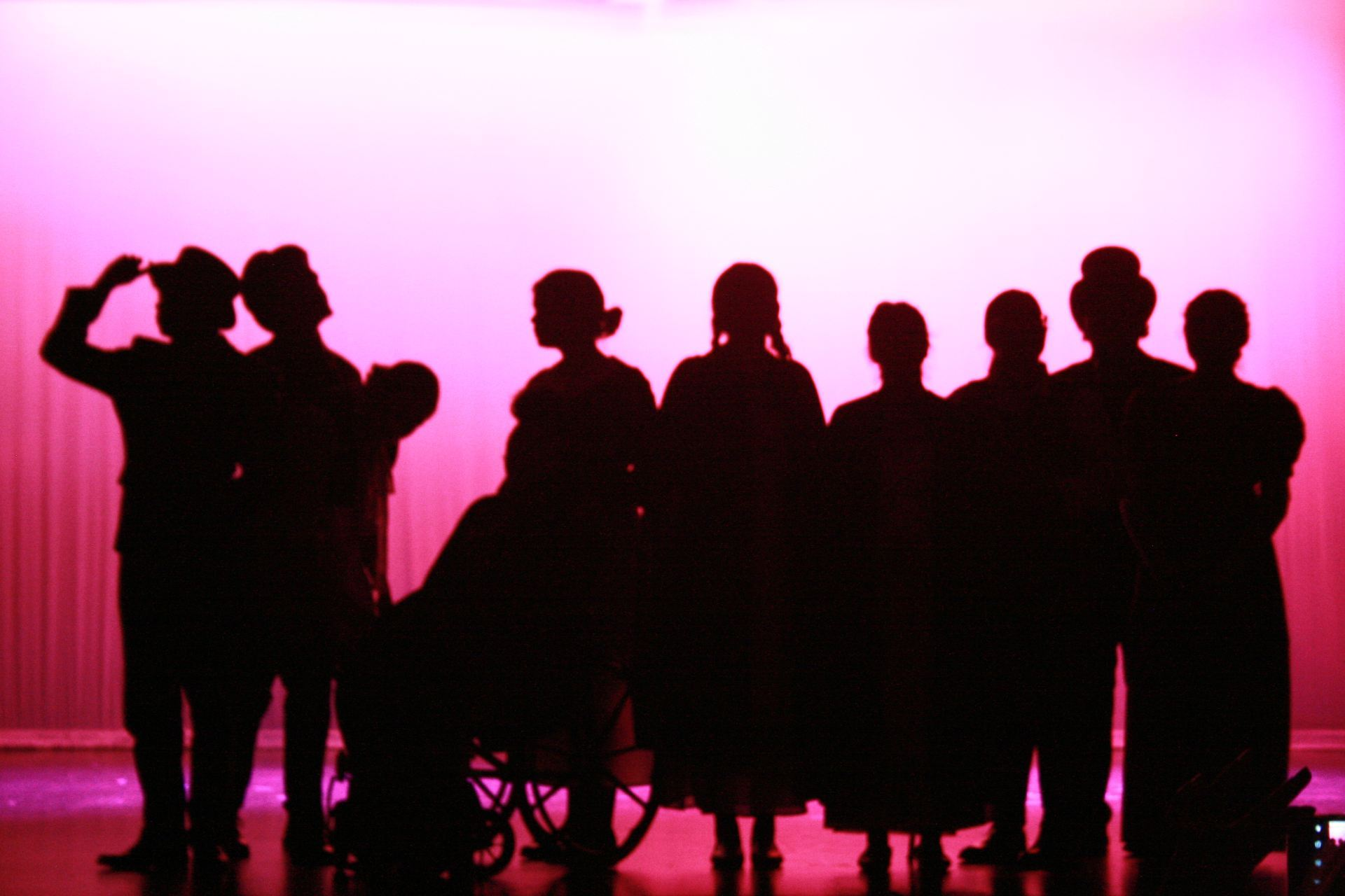 Silhouette of actors on stage